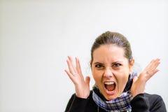 Uma senhora que grita na frustração imagem de stock royalty free