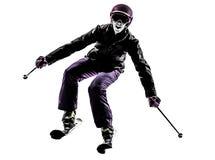Uma silhueta do esqui do esquiador da mulher fotografia de stock royalty free