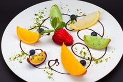 Uma sobremesa do fundo preto Imagem de Stock