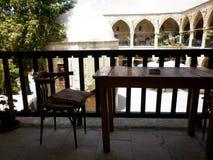 Uma tabela, uma cadeira, um descanso Imagem de Stock
