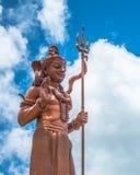 Uma Thevi. Statue under blue sky Stock Photo