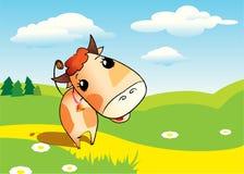 Uma vaca bonito dos desenhos animados no campo Fotografia de Stock