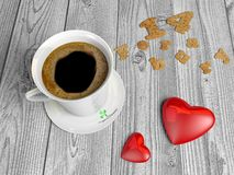 Uma xícara de café e dois corações Fotografia de Stock Royalty Free