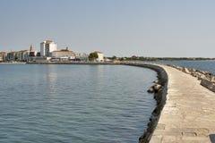 Umag breakwater. Bay wall (breakwater) in Umag, Istria, Croatia Royalty Free Stock Photos
