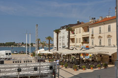 Umag central square. Workers instal show scene on the central square of mediterranean town Umag, Croatia. Umag is a coastal town in Istria, it hosts the yearly royalty free stock photos