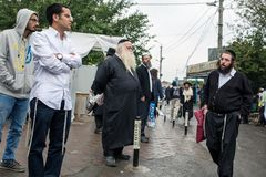 Uman,Ukraine, 13.09.2015: Jewish men in Kippah and black clothes with beards are in the street. Rosh Hashanah royalty free stock image