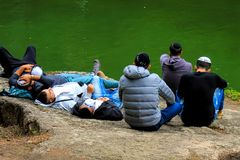 Young men, Hasidim Jews resting on a big stone in Sophia`s park during the Jewish New Year. stock photos