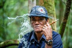 Umar - the Indonesian guide, smokes a cigaret. Royalty Free Stock Photos