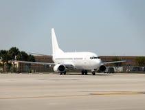Umarked passenger jet airplane Stock Photography