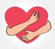 Umarmen Sie das Herz, Symbol der Liebe sich Stockfoto