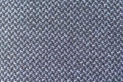 Umas fibras cinzentas mais escuras e mais claras da tela fecham-se acima Foto de Stock