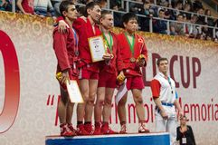Umbaev N , Kanzhanov B , Klyukin A , Yamamoto K op podium Stock Foto's