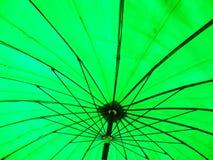 Umbella verde Fotos de archivo libres de regalías