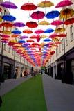 Fun, art installation, coloured umbrellas covering a shopping street. Stock Photos