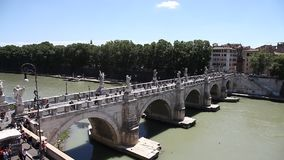 Umberto I bridge. Rome, Italy - June 17, 2016: Umberto I bridge in Rome city, Italy, with tourists located on Tiber river. on top of roman Castel Sant'Angelo stock video