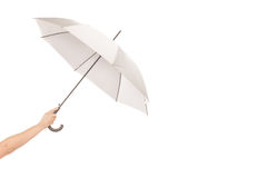 Umbrela en una mano Imagenes de archivo