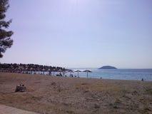 umbrelas dell'acqua del sole di estate della spiaggia Fotografie Stock Libere da Diritti