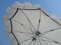 Umbrella. White beach umbrella Stock Photo