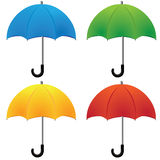 Umbrella. Nice blue red green and yellow umbrella isolated on white background Stock Photos