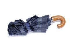 Umbrella. A check umbrella isolated on a white background Stock Photo