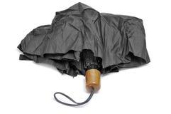 Umbrella. A black umbrella isolated on a white background Royalty Free Stock Photos