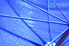 Umbrella. Underside of an umbrella shot with water drops Stock Image