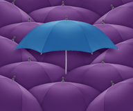 Umbrella. Blue umbrella Stand out of a crowd, individuality and unique Stock Photos