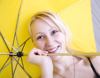Umbrella. Blond woman smiling and playing with umbrella royalty free stock photos