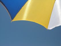 Umbrella. Blue, yellow, white umbrella detail stock photos