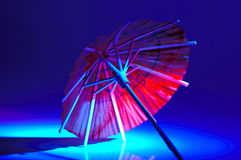 Umbrella. Cocktail Umbrella With Colored Gel Lighting Royalty Free Stock Image