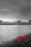 Umbrella. A broken red umbrella in the port of Rotterdam stock photography