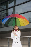 Umbrella. Woman with umbrella in the colors of the rainbow Royalty Free Stock Photos