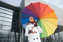 Umbrella. Woman with umbrella in the colors of the rainbow Royalty Free Stock Images