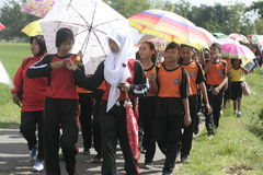 In the umbrella action Commemorating Teachers' Day. Thousands of school children walking using an umbrella to accompany their teachers in action to celebrate the Royalty Free Stock Photo