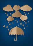 Umbrella in the air with rain. Cardboard umbrella in the air with rain Stock Images