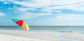 Single Umbrella on beach background Royalty Free Stock Photos