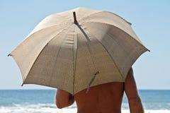 Umbrella as sun protection. Umbrella as protection against the sun Royalty Free Stock Photo