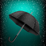 Umbrella and azure snow background Royalty Free Stock Photography