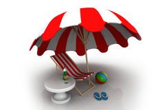 An umbrella, ball, drinks, beach chair Royalty Free Stock Images