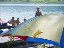 Umbrella by the bathing lake Stock Photo