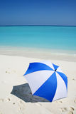 Umbrella on the beach. Blue and white umbrella on the beach Royalty Free Stock Photos