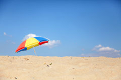 Umbrella at beach. In sand Royalty Free Stock Image