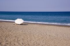Umbrella on a beach. Lonely umbrella on a beach Stock Image
