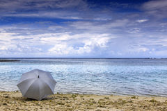 Umbrella by the beach Royalty Free Stock Photography