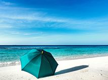 Umbrella is on a beach Stock Photos