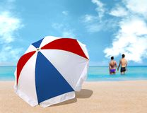 Umbrella on the beach Stock Images