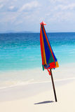 Umbrella on the beach. Umbrella and beautiful beach with sea Royalty Free Stock Image