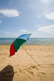 Umbrella & beach Stock Images