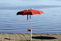 An umbrella on the beach Royalty Free Stock Images