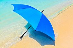 Umbrella on a  beach Stock Images